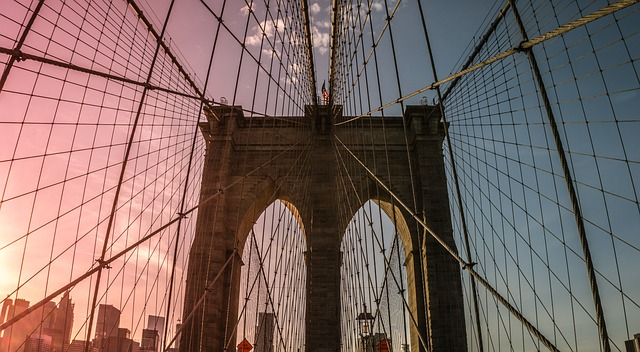 A photo of Brooklyn Bridge at sunset.