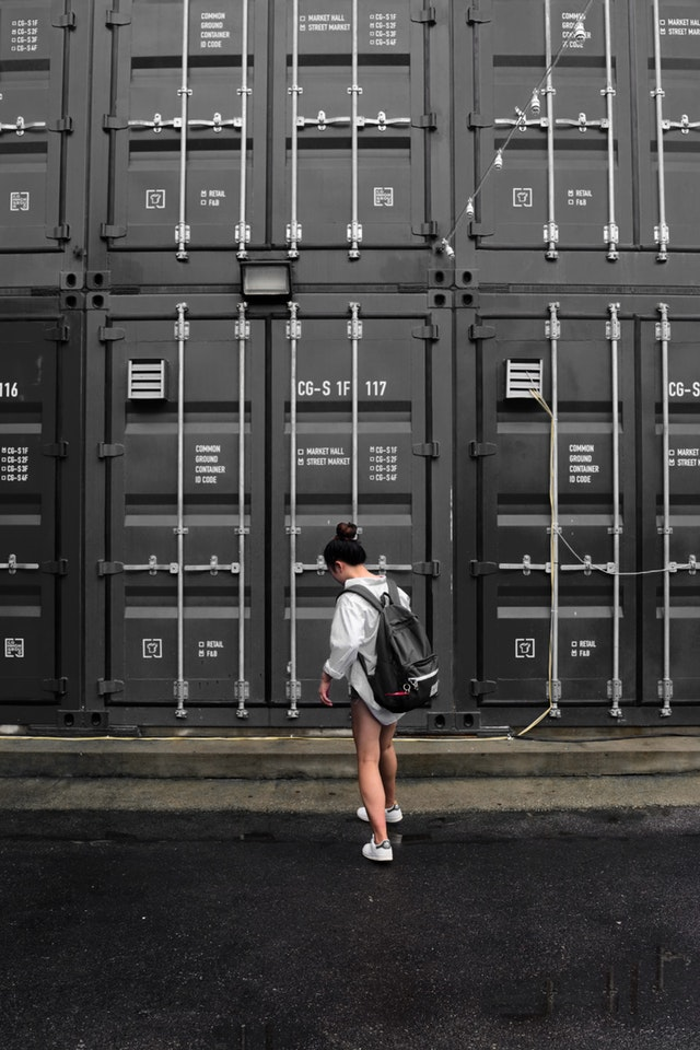 girl in front of the storage containers
