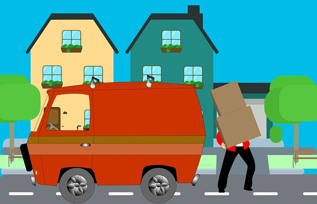 Man loading moving boxes into a moving van during DIY move to NYC