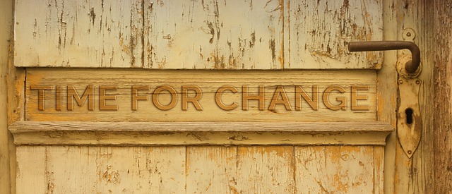 Time for change inscription on old doors