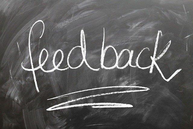 """A word """"feedback"""" writing on a black board."""