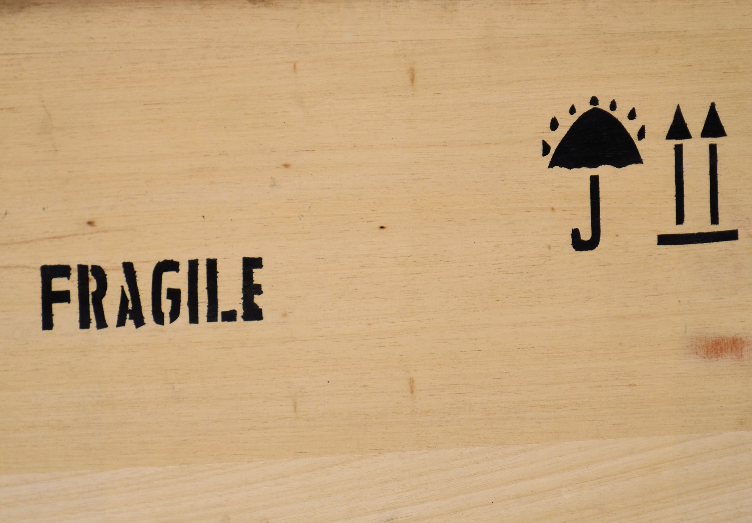 The word fragile written on a cardboard box you can use to get your gadgets ready for a long distance journey.