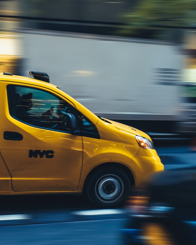 A yellow moving van moving from Kentucky to NYC.