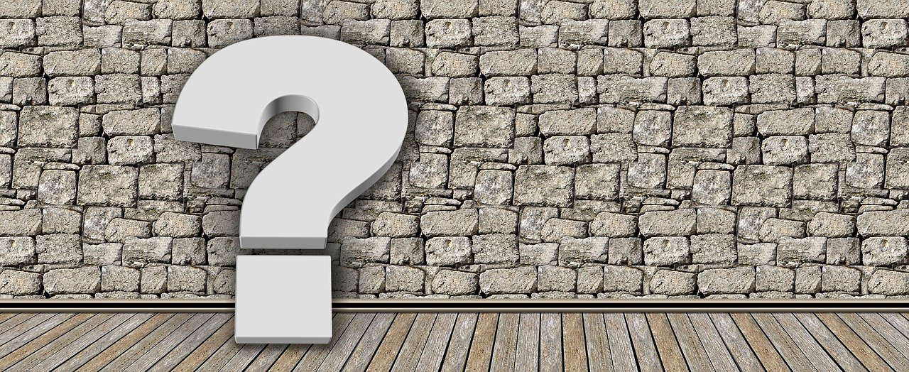An illustration of a question mark leaning on a brick wall and representing all the common problems New Yorkers with kids are facing during relocation.