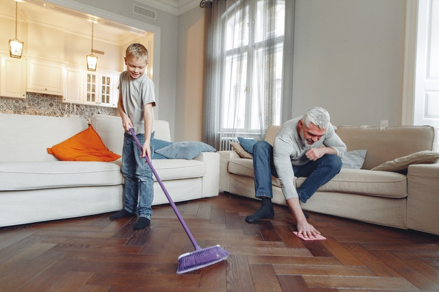 A family is cleaning a home.